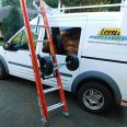 Dolly attching to ladder on utility van